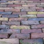 Oud gebakken Klinkers Waalformaat bont straat
